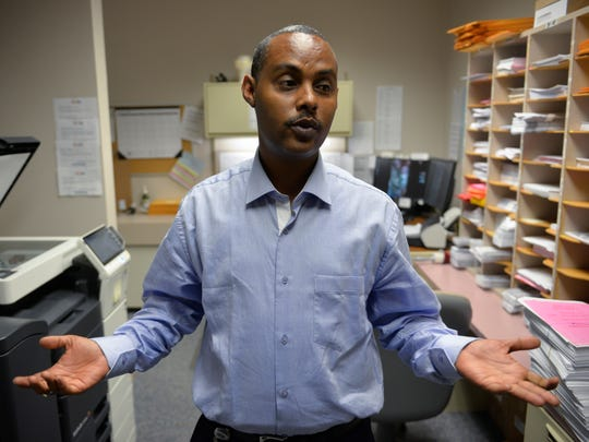 Interpreter Abdikadir Gaal talks Tuesday, May 17, 2016, about his job during a break in his shift at Stearns County Social Services.