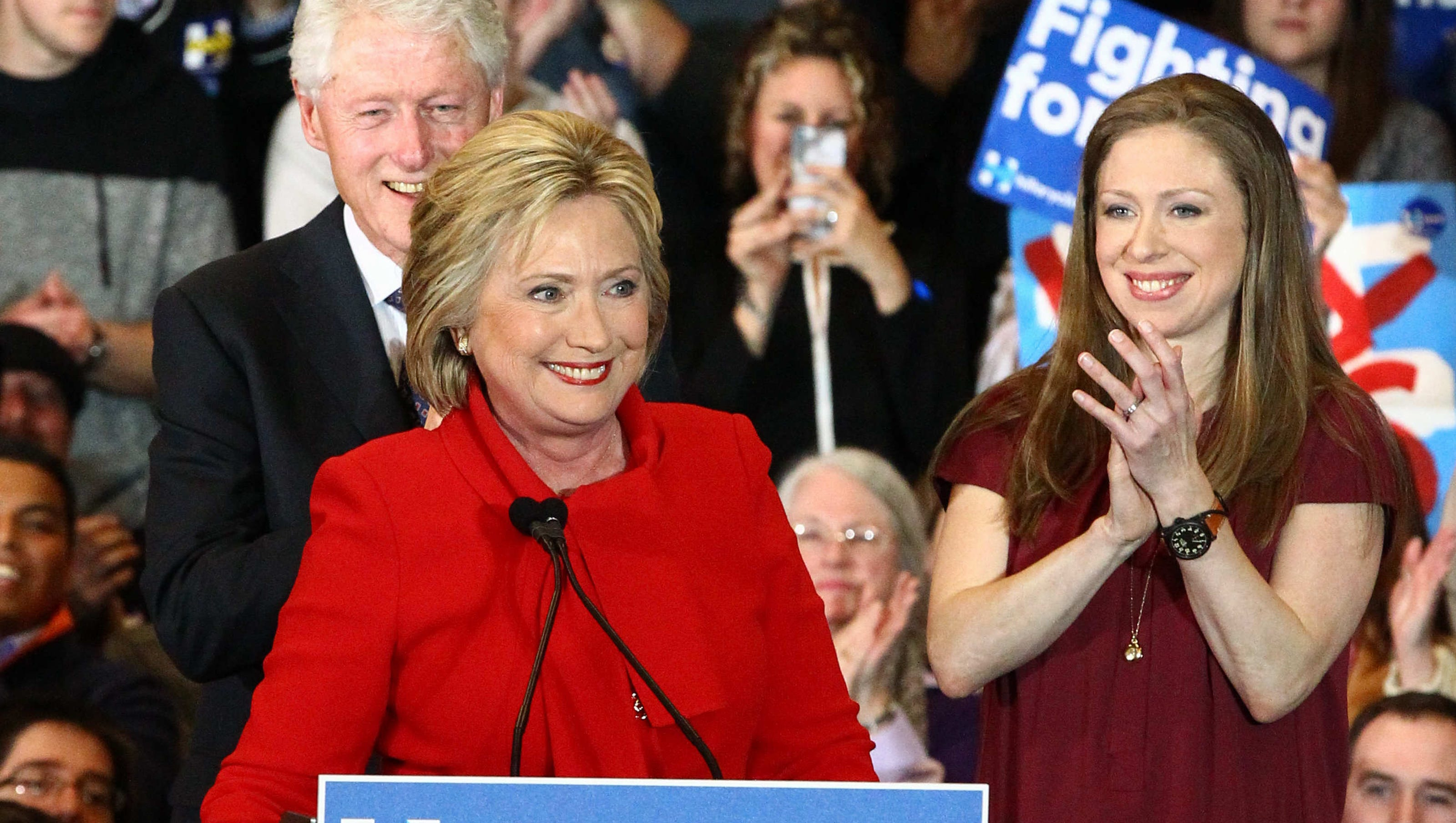 Clinton vows to fight on with razor-thin lead