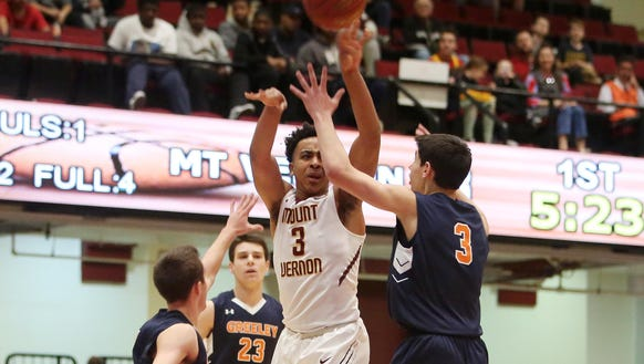 Mount Vernon's Chase Johnson (3) passes over Greeley's