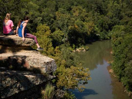 Sarah Ferrell, left, 19, of Dickson, and Hannah Gentry, 22, of Dickson, stop to enjoy the view of the Harpeth River on Sept. 2, 2016, in Kingston Springs, Tenn.