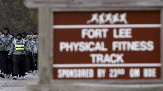 In this 2006 photo, members of Alpha Company of the 244th Quartermasters battalion march to the physical fitness track at the Fort Lee Army post near Richmond, Va.