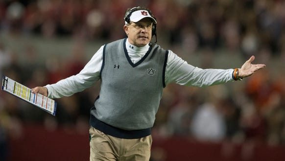 Auburn Head Coach Gus Malzahn argues with a referee