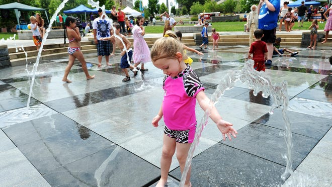 Splashville fountains in Pack Square Park have become popular in recent days with climbing temperatures.
