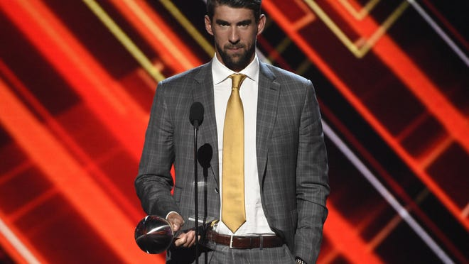 Michael Phelps accepts the award for best record-breaking performance at the ESPYS on July 12, 2017, in Los Angeles.