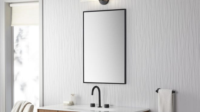 Many wall-mounted sconces not only brighten up a bathroom, they can also be used for mood lighting when you install a dimmer switch.