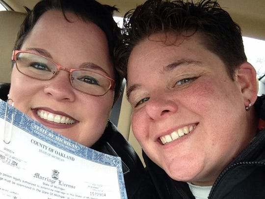 Cass Varner, left, and Sheri Folta of Ferndale were one of 322 same-sex couples to marry when Michigan's gay marriage ban was lifted briefly last year. They had had a commitment ceremony four years before.