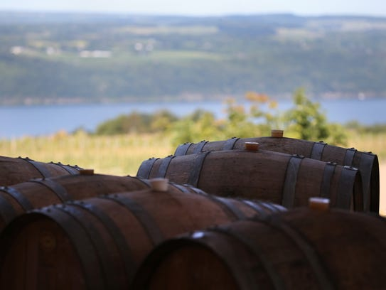 Empty barrels made in France sit outside Forge Cellars