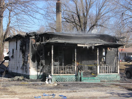 A passer-by called for help after seeing flames coming from the corner of this home in Bolivar early New Year's Day.