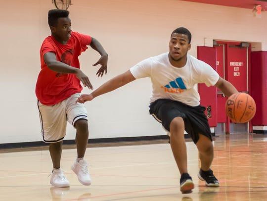 Charles Stephenson, left, and Shelby Cotton play basketball