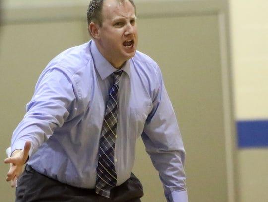 Oak Creek boys Basketball Coach Mike Jossie shouts