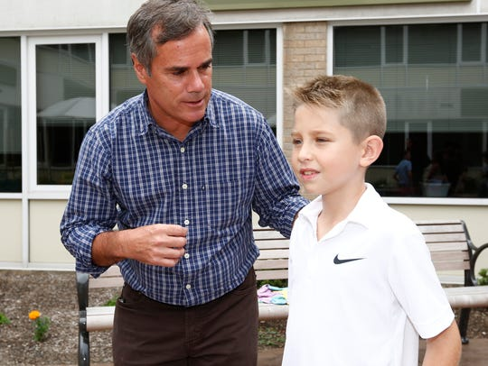 Special education teacher David Celli, left, with Nick