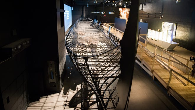 """The Roskilde 6, a 122-foot Viking war ship, sits on display in the Cincinnati Museum Center for the """"Vikings: Beyond the Legend"""" exhibit."""