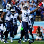 Titans outside linebacker Akeem Ayers (56) celebrates a defensive stop against the Chargers in a game at LP Field last year in Nashville. Ayers has been traded to the Patriots.