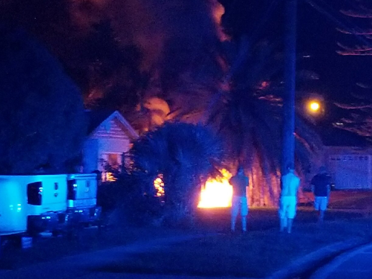 A car burst into flames after striking a power pole
