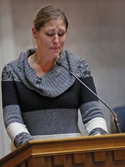 Melissa Klein becomes emotional as she talks about her troubles after denying to make a same-sex wedding cake at her Oregon business, talking in the Senate chambers against LGBT legislation on Jan. 27, 2016.