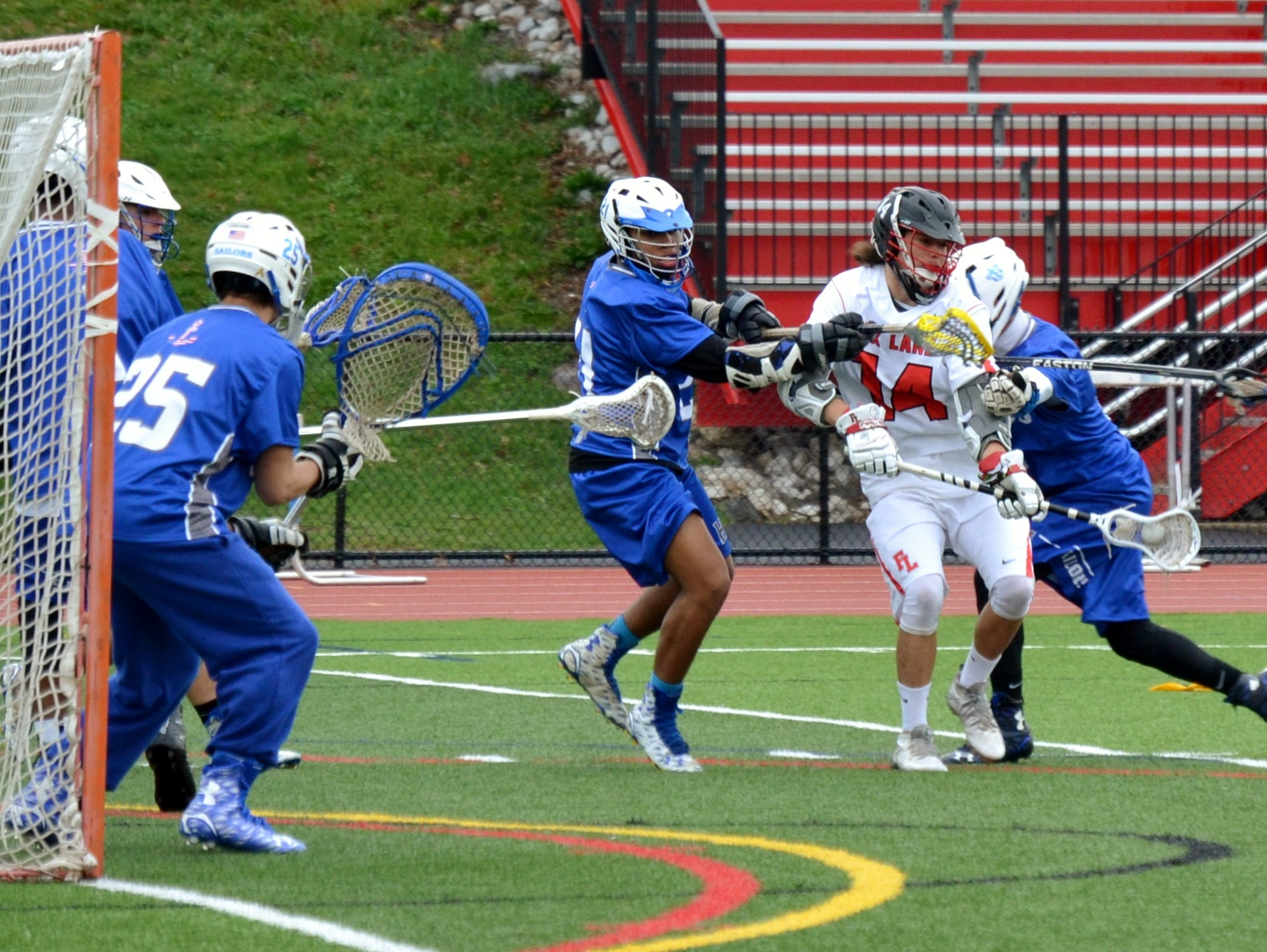 Fox Lane midfielder Thomas Tenney draws a double team Saturday during a 17-7 win over Hen Hud.