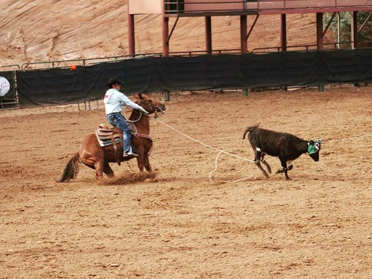 Nick Felix III competes in the New Mexico High School Rodeo State Finals in Gallup on May 28. At the event, Felix and his partner won the round of team roping with a time of 6.3 seconds.