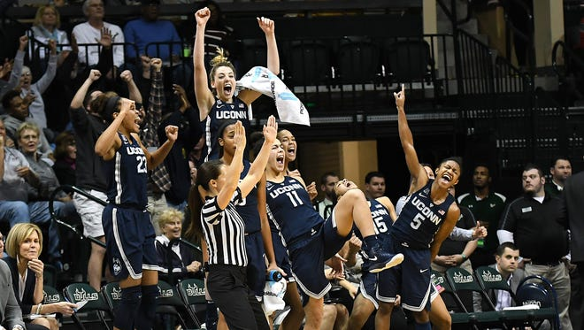 Connecticut's women's basketball team celebrates during its win against South Florida at USF Sun Dome in Tampa.