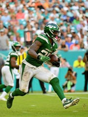 Nov 3, 2019; Miami Gardens, FL, USA; New York Jets running back Le'Veon Bell (26) runs the ball against the Miami Dolphins during the second half at Hard Rock Stadium. Mandatory Credit: Jasen Vinlove-USA TODAY Sports