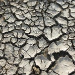 The Tule River bed stands dry in California.