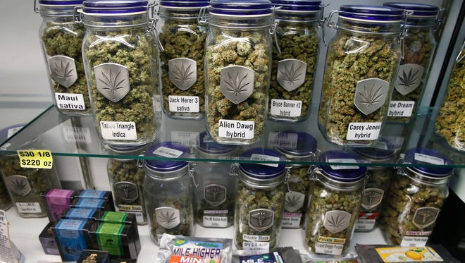 Marijuana and cannabis-infused products are displayed for sale at Medicine Man marijuana dispensary, which opened as a recreational retail outlet Jan. 1, in Denver.