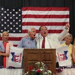 """Judge Christopher Shea Nickell, wearing glasses, leads Governor Steve Beshear's family in a rendition of """"My Old Kentucky Home"""" during the Graves County Democratic Breakfast at the Mayfield High School. Aug. 1, 2015"""