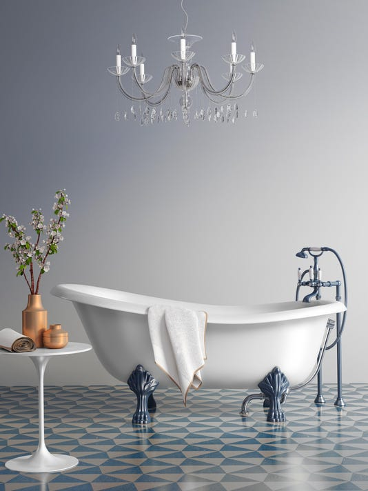 Blue bathroom with vintage bathtub