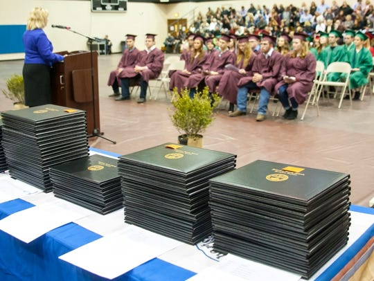 Diplomas are stacked, waiting to be handed out during