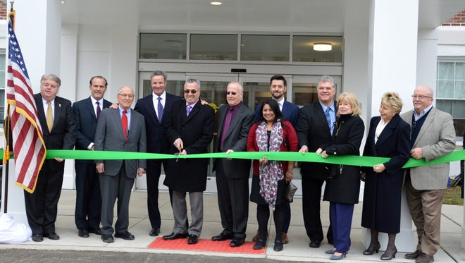 Officials celebrate the grand opening of the Residence at Roosevelt Park in Edison on April 11.