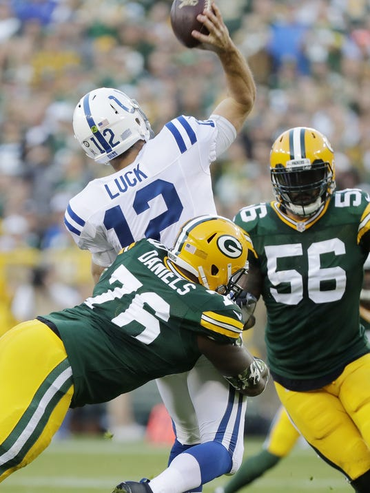 Mike Daniels, Andrew Luck