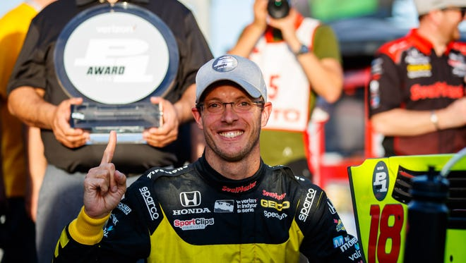 IndyCar driver Sebastien Bourdais celebrates after winning the pole position during qualifying for the Phoenix Grand Prix at ISM Raceway.