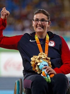 Rachael Morrison is recognized as a Paralympic champion during the awards ceremony in Rio de Janeiro.