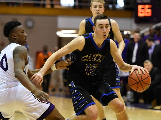 Castle's Alex Hemenway, dribbling past Ben Davis' KeSean Tunstill in the Class 4A semistate, is ranked as the No. 3 junior in the state and has received nine Division I offers.