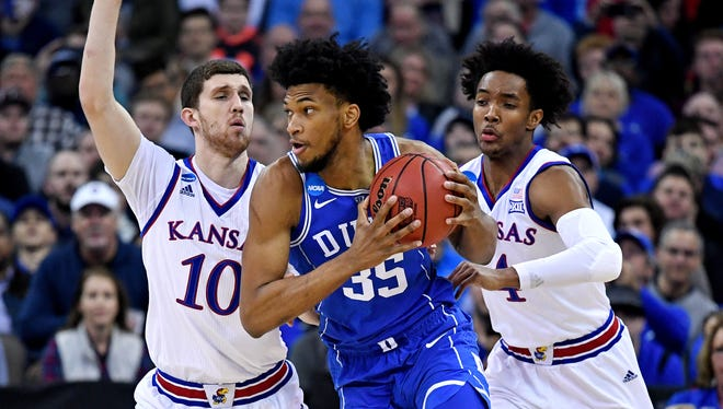 Duke Blue Devils forward Marvin Bagley III (35) drives to the basket against Kansas Jayhawks guard Sviatoslav Mykhailiuk (10) during the first half in the semifinals of the Midwest regional of the 2018 NCAA Tournament at CenturyLink Center.