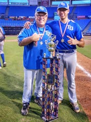 Post 13 manager Wes Singletary and TCC pitcher Thomas Nicoll celebrate an American Legion state title, the first by Tallahassee Post 13 in 44 years.