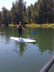 Paddle boarding on the Deschutes River at Sunriver.