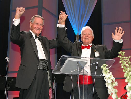 """Florida Institute of Technology Board of Trustees Chairman Phil Farmer (left) and President and CEO Anthony Catanese celebrate generating $123.4 million during the """"Create the Future"""" fundraising campaign."""