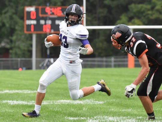 Dakota Valley Sam Chesterman (23) runs the ball during