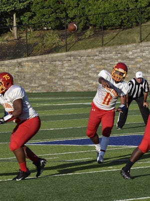 Purcell Marian quarterback Mitch Mayes (11)  fires a strike for a completed pass and a first down for the Cavaliers.