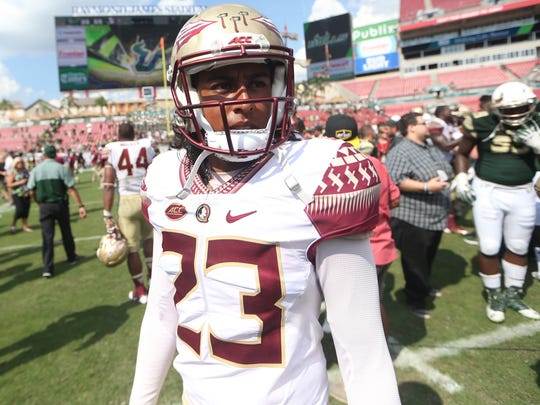 FSU's Ricky Aguayo walks off the field after their win against USF at Raymond James Stadium last season.