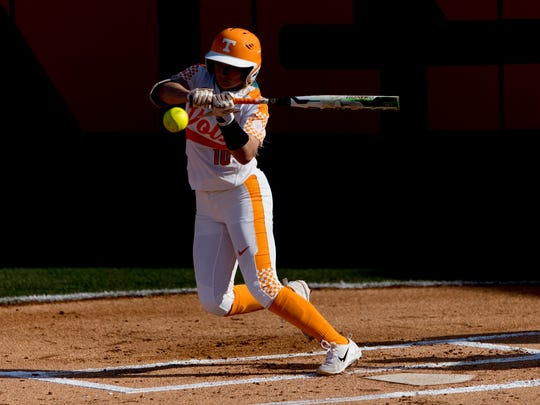 Tennessee infielder Aubrey Leach (10) hits the ball during a game between Tennessee and Georgia at Sherri Parker Lee Stadium in Knoxville, Tennessee on Saturday, March 31, 2018.