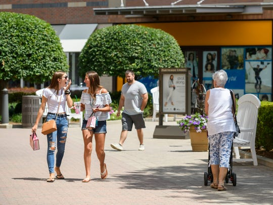 Shoppers enjoy a warm summer afternoon at the outdoor