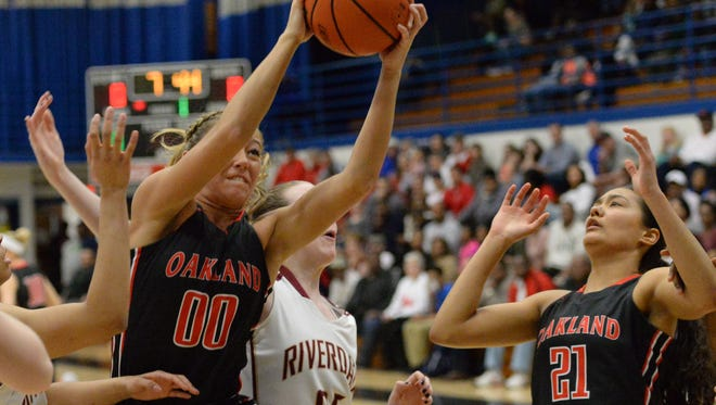 Oakland's Ansley Eubank drives to the basket during the Lady Patriots' win over Riverdale on Saturday night in the District 7-AAA tournament semifinals.