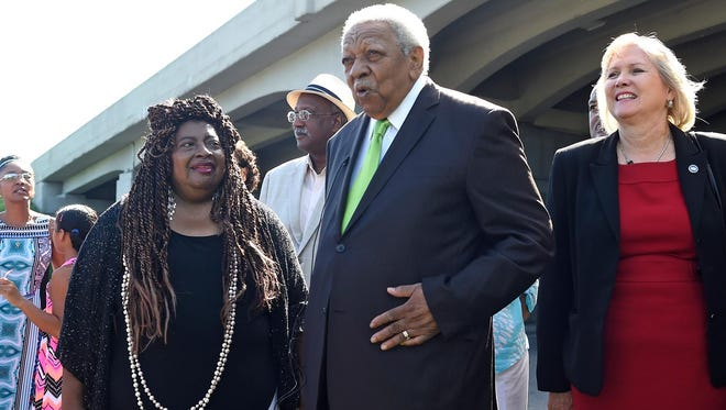 Avon Rollins Sr. addresses the crowd as his wife, Sheryl Rollins, left, and state Sen. Becky Massey, right, stand by, following a ceremony christening the I-40 overpass above Cherry Street in his honor in Knoxville on Friday, July 31, 2015.