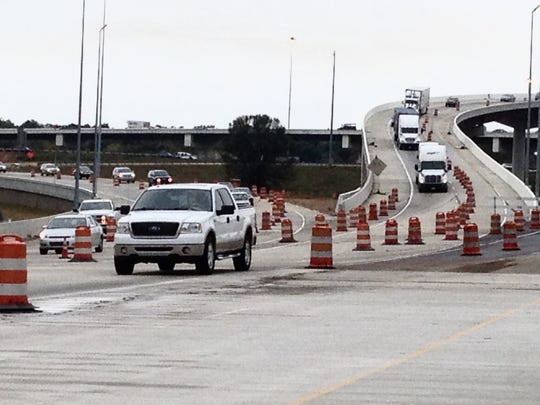 Traffic moves through the Wolf River Bridge construction