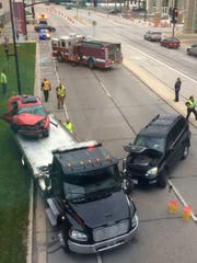 The two vehicles in a head-on collision on Main Street in downtown Green Bay are towed from the scene Thursday, Sept. 24.