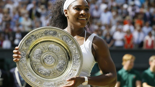 Serena Williams, of the United States, holds up the trophy after winning the women's singles final against Garbine Muguruza, of Spain, at the All England Lawn Tennis Championships on July 11, 2015, in Wimbledon, London. Williams won 6-4, 6-4.