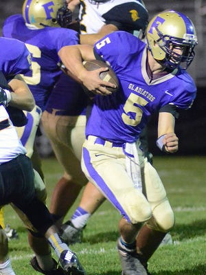 Fowlerville quarterback Nick Semke, shown last season, threw for two touchdowns but saw another pass intercepted for a touchdown in Friday's 49-14 loss to Portland.