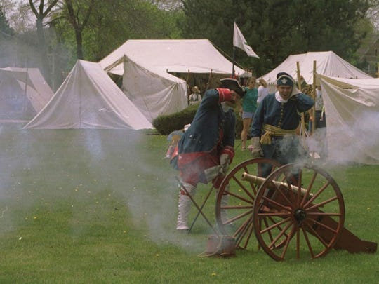 Re-enactors blast away with an 18th-century cannon during the Feast of the Ste. Claire at Pine Grove Park in Port Huron. You don't have to add cannon-firing to your bucket list, but you don't want to miss the re-enactors who take over the park Memorial Day weekend.