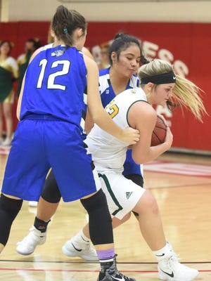 Cotter's Macie Clawson (12) and Samantha Sanchez trap Omaha's Macie Arnold during the Lady Warriors' 47-38 victory Thursday night at Harrison.